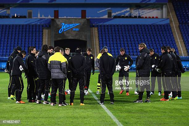 Head coach Juergen Klopp of Dortmund talks to the players during a training session ahead of the UEFA Champions League Round of 16 first leg match...