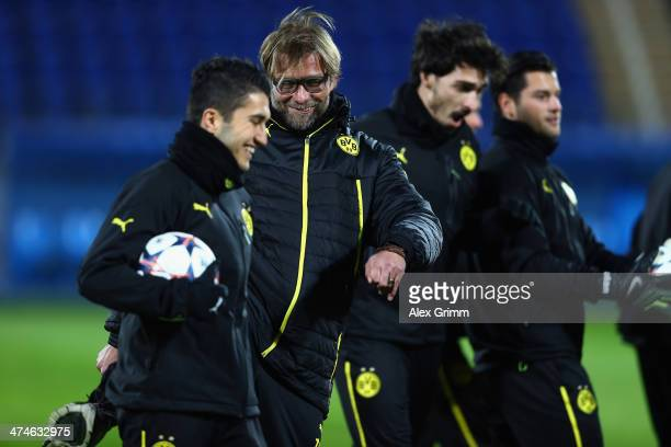 Head coach Juergen Klopp of Dortmund tries to kick Nuri Sahin during a training session ahead of the UEFA Champions League Round of 16 first leg...