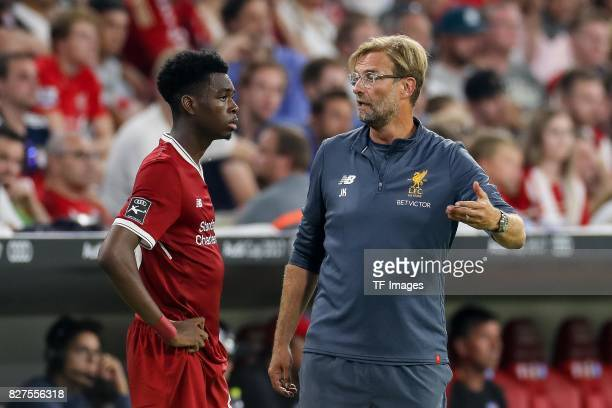 Head coach Juergen Klopp of Liverpool speak with Ovie Ejaria of Liverpool during the Audi Cup 2017 match between Liverpool FC and Atletico Madrid at...