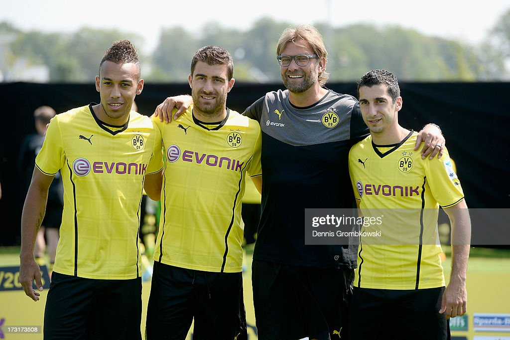 Head coach Juergen Klopp poses with new players Pierre-Emerick Aubameyang (L), Sokratis (2nd L) and Henrikh Mkhitaryan (R) during the Borussia Dortmund Team Presentation at Brackel Training Ground on July 9, 2013 in Dortmund, Germany.