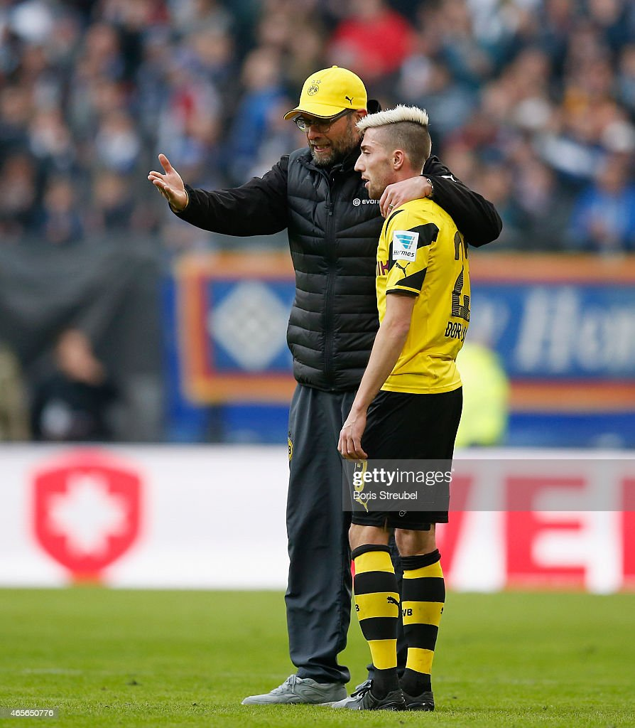 Head coach Juergen Klopp (L) reacts with <a gi-track='captionPersonalityLinkClicked' href=/galleries/search?phrase=Kevin+Kampl&family=editorial&specificpeople=6527116 ng-click='$event.stopPropagation()'>Kevin Kampl</a> of Dortmund after the First Bundesliga match between Hamburger SV and Borussia Dortmund at Imtech Arena on March 7, 2015 in Hamburg, Germany.