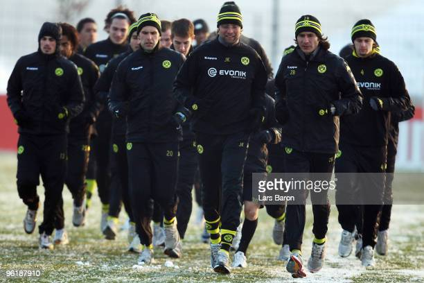 Head coach Juergen Klopp runs with his players during a Borussia Dortmund training session on January 26 2010 in Dortmund Germany