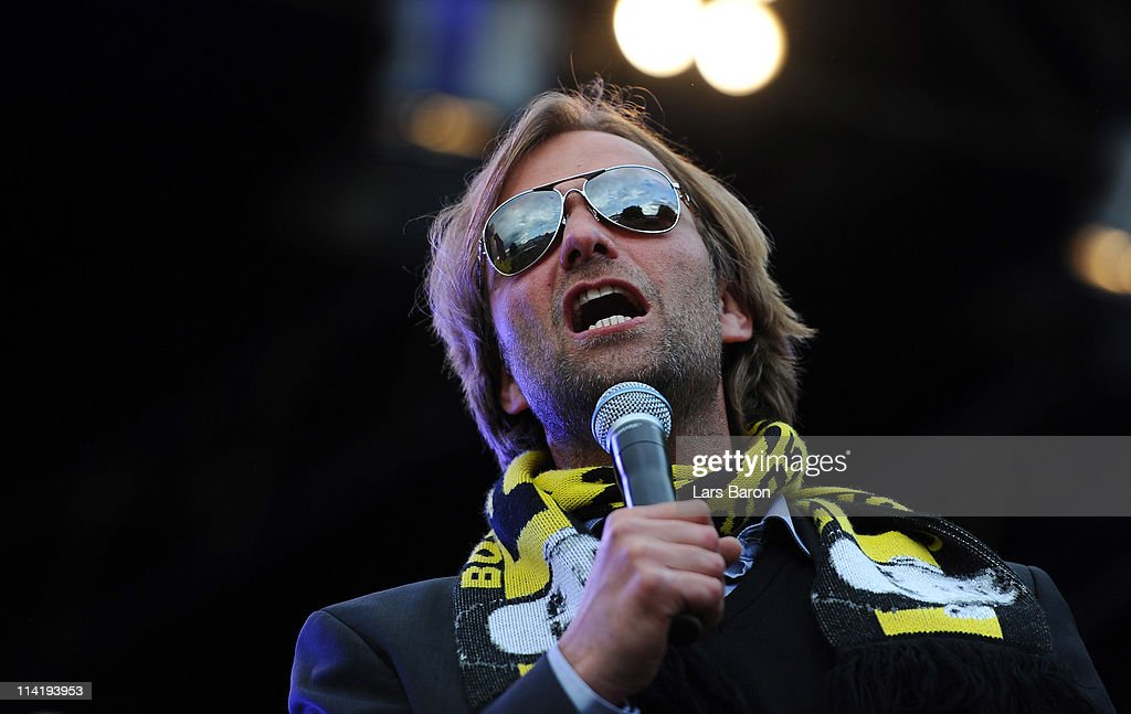 Head coach Juergen Klopp sings on the stage during the Borussia Dortmund Bundesliga winners parade at Westfalenhalle on May 15, 2011 in Dortmund, Germany.