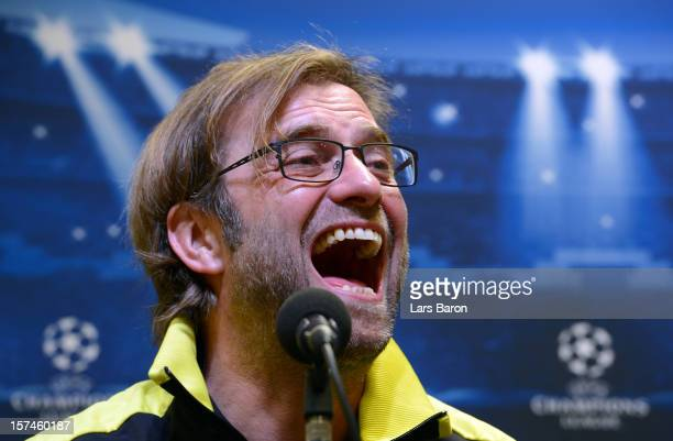 Head coach Juergen Klopp smiles during a Borussia Dortmund press conference ahead of their UEFA Champions League group stage match against Manchester...