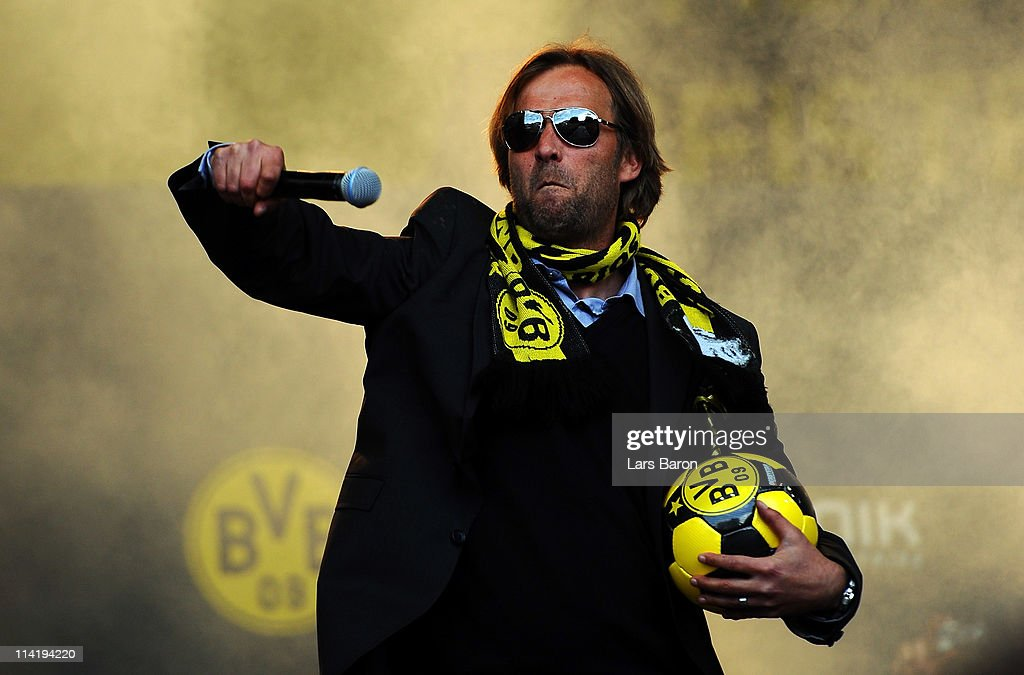 Head coach Juergen Klopp smiles on the stage during the Borussia Dortmund Bundesliga winners parade at Westfalenhalle on May 15, 2011 in Dortmund, Germany.