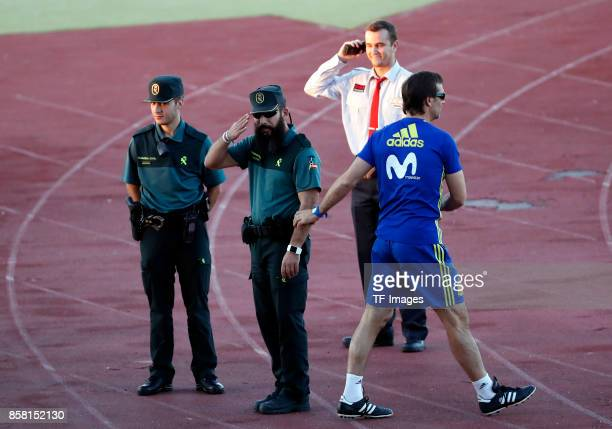 Head coach Julen Lopetegu of Spain shakes hands withwith a Police during a training session on October 2 2017 in Madrid Spain