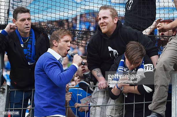 Head coach Julian Nagelsmann of 1899 Hoffenheim celebrates with fans after the Bundesliga match between 1899 Hoffenheim and FC Schalke 04 at Wirsol...