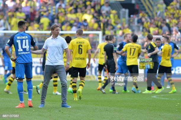 Head coach Julian Nagelsmann of Hoffenheim a shakes hands with Sandro Wagner of Hoffenheim a 'n during the Bundesliga match between Borussia Dortmund...