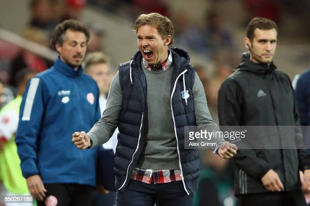 Head coach Julian Nagelsmann of Hoffenheim celebrates after the final whistle of the Bundesliga match between 1 FSV Mainz 05 and TSG 1899 Hoffenheim...