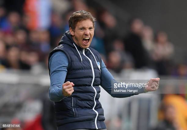 Head coach Julian Nagelsmann of Hoffenheim celebrates after winning the Bundesliga match between TSG 1899 Hoffenheim and Bayer 04 Leverkusen at...