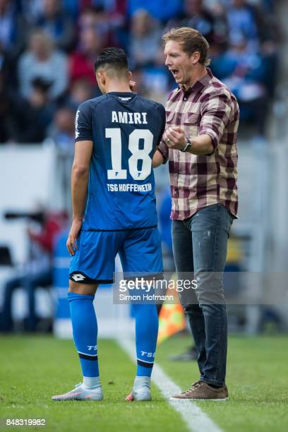 Head coach Julian Nagelsmann of Hoffenheim gives directions to Nadiem Amiri during the Bundesliga match between TSG 1899 Hoffenheim and Hertha BSC at...
