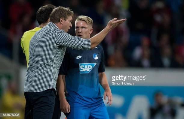 Head coach Julian Nagelsmann of Hoffenheim gives directions to Philipp Ochs during the Bundesliga match between TSG 1899 Hoffenheim and FC Bayern...