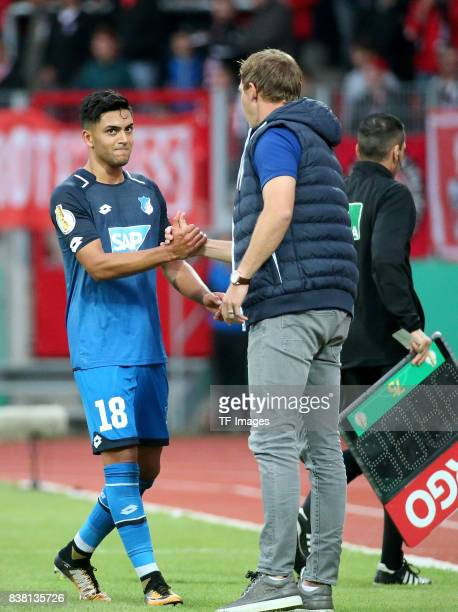 Head coach Julian Nagelsmann of Hoffenheim shakes hands with Nadiem Amiri of Hoffenheim during the DFB Cup first round match between RotWeiss Erfurt...