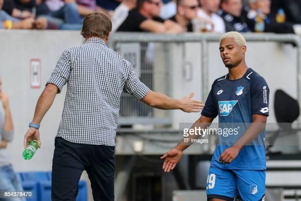 Head coach Julian Nagelsmann of Hoffenheim shakes hands with Serge David Gnabry of Hoffenheim during the Bundesliga match between TSG 1899 Hoffenheim...