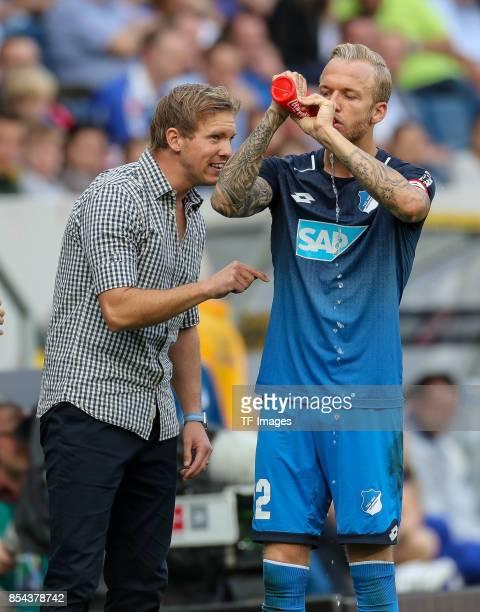 Head coach Julian Nagelsmann of Hoffenheim speak with Kevin Vogt of Hoffenheim during the Bundesliga match between TSG 1899 Hoffenheim and FC Schalke...