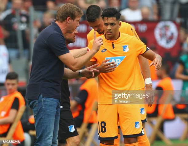 Head coach Julian Nagelsmann of Hoffenheim speak with Nadiem Amiri during the Bundesliga match between Bayer 04 Leverkusen and TSG 1899 Hoffenheim at...