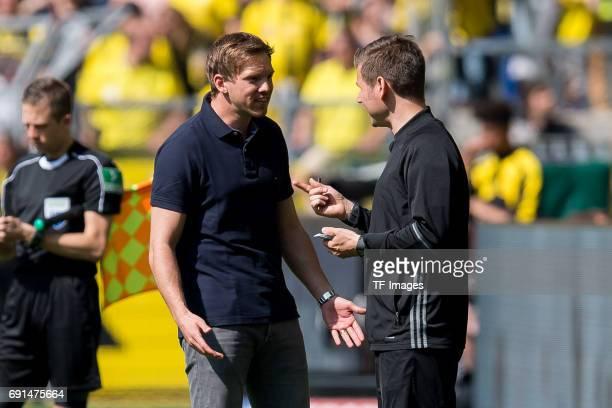 Head coach Julian Nagelsmann of Hoffenheim speak with Referee assistent Mark Borsch during the Bundesliga match between Borussia Dortmund and TSG...