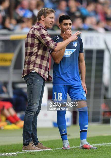 Head coach Julian Nagelsmann of Hoffenheim talks to Nadiem Amiri of Hoffenheim during the Bundesliga match between TSG 1899 Hoffenheim and Hertha BSC...