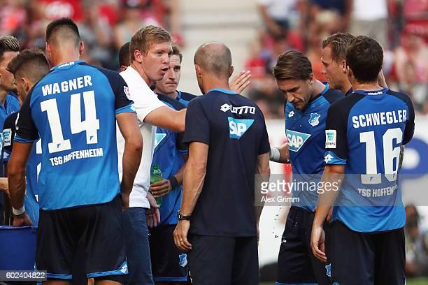 Head coach Julian Nagelsmann of Hoffenheim talks to the players during the Bundesliga match between 1 FSV Mainz 05 and TSG 1899 Hoffenheim at Opel...