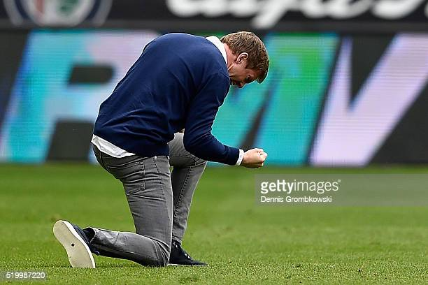 Head coach Julian Nageslmann of 1899 Hoffenheim celebrates the first goal during the Bundesliga match between Eintracht Frankfurt and 1899 Hoffenheim...