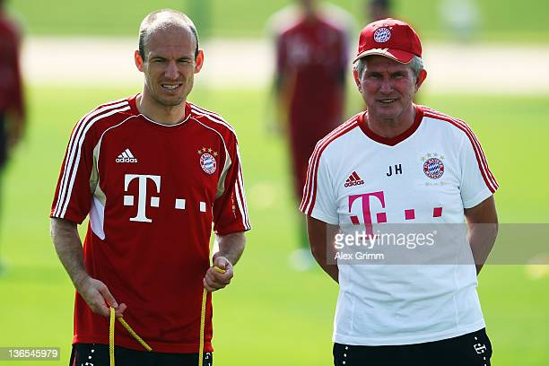 Head coach Jupp Heynckes and Arjen Robben look on during a training session of Bayern Muenchen at the ASPIRE Academy for Sports Excellence on January...