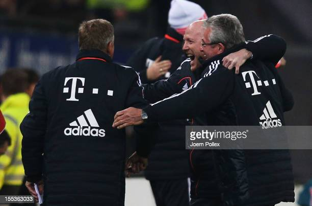 Head coach Jupp Heynckes and Matthias Sammer sport director of Muenchen celebrate after Thomas Mueller scored his team's second goal during the...