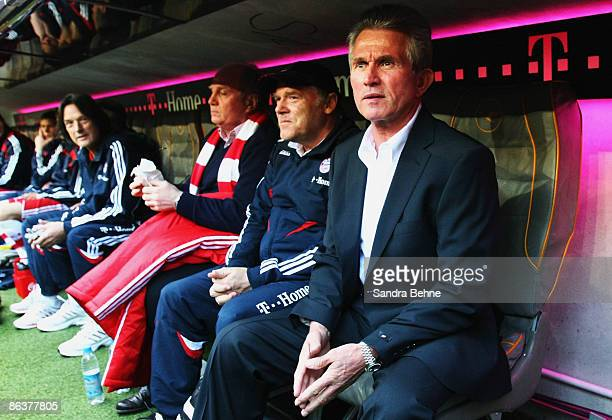 Head coach Jupp Heynckes assistant coach Hermann Gerland and manager Uli Hoeness of Bayern sit on the bench during the Bundesliga match between FC...