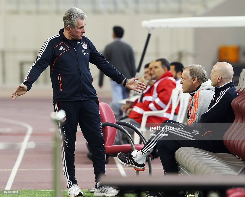 Head coach <a gi-track='captionPersonalityLinkClicked' href=/galleries/search?phrase=Jupp+Heynckes&family=editorial&specificpeople=2062040 ng-click='$event.stopPropagation()'>Jupp Heynckes</a>, assistant coach <a gi-track='captionPersonalityLinkClicked' href=/galleries/search?phrase=Hermann+Gerland&family=editorial&specificpeople=5501832 ng-click='$event.stopPropagation()'>Hermann Gerland</a> and <a gi-track='captionPersonalityLinkClicked' href=/galleries/search?phrase=Matthias+Sammer&family=editorial&specificpeople=555228 ng-click='$event.stopPropagation()'>Matthias Sammer</a> (L-R) discuss prior to the international friendly match between Lekhwiya Sports Club and FC Bayern Muenchen at Khalifa International Stadium on January 5, 2013 in Doha, Qatar.