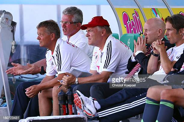Head coach Jupp Heynckes assistant coach Peter Herrmann assistant coach Hermann Gerland and sporting director Matthias Sammer of Bayernsit on the...