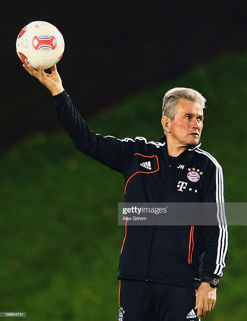 Head coach <a gi-track='captionPersonalityLinkClicked' href=/galleries/search?phrase=Jupp+Heynckes&family=editorial&specificpeople=2062040 ng-click='$event.stopPropagation()'>Jupp Heynckes</a> holds the ball during a Bayern Muenchen training session at the ASPIRE Academy for Sports Excellence on January 3, 2013 in Doha, Qatar.