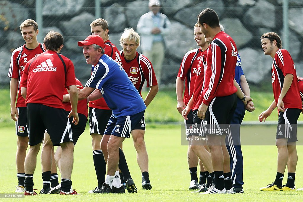 Head coach <a gi-track='captionPersonalityLinkClicked' href=/galleries/search?phrase=Jupp+Heynckes&family=editorial&specificpeople=2062040 ng-click='$event.stopPropagation()'>Jupp Heynckes</a> laughs with players during the training camp of Bayer 04 Leverkusen at the training ground Gruendenmoos on July 27, 2010 in St Gallen, Switzerland.