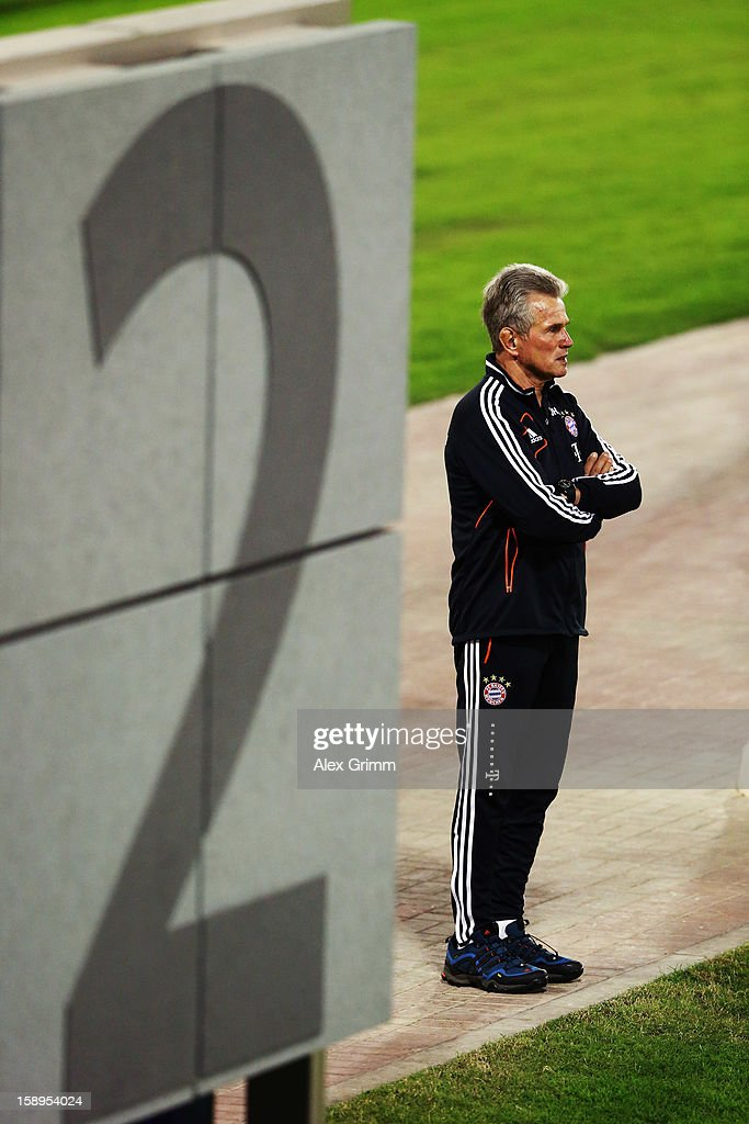 Head coach <a gi-track='captionPersonalityLinkClicked' href=/galleries/search?phrase=Jupp+Heynckes&family=editorial&specificpeople=2062040 ng-click='$event.stopPropagation()'>Jupp Heynckes</a> looks on during a Bayern Muenchen training session at the ASPIRE Academy for Sports Excellence on January 4, 2013 in Doha, Qatar.