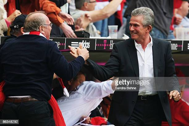 Head coach Jupp Heynckes of Bayern celebrates his team's second goal with manager Uli Hoeness during the Bundesliga match between FC Bayern Muenchen...