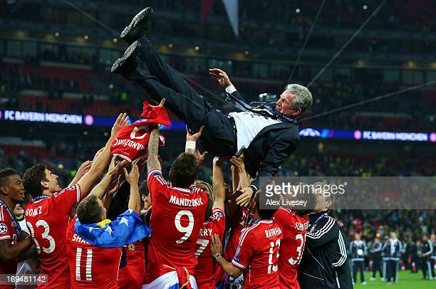 Head Coach Jupp Heynckes of Bayern Muenchen is thrown into the air by his players after winning the UEFA Champions League final match against...