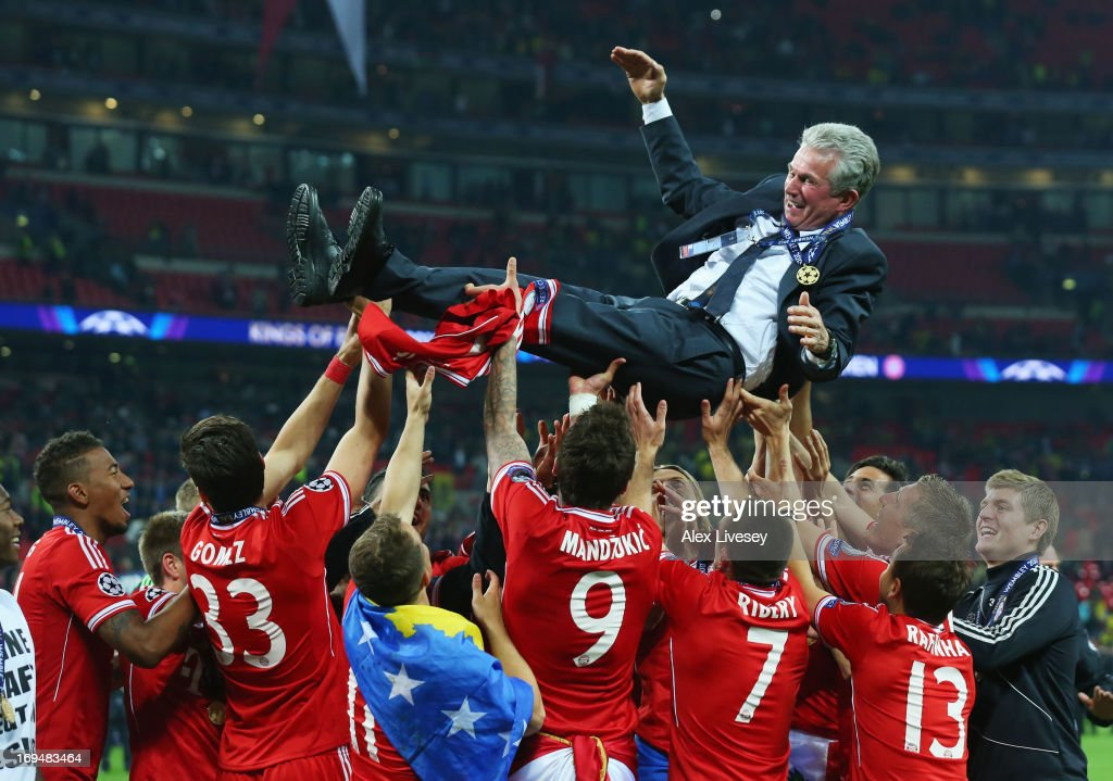 Head Coach <a gi-track='captionPersonalityLinkClicked' href=/galleries/search?phrase=Jupp+Heynckes&family=editorial&specificpeople=2062040 ng-click='$event.stopPropagation()'>Jupp Heynckes</a> of Bayern Muenchen is thrown into the air by his players after winning the UEFA Champions League final match against Borussia Dortmund at Wembley Stadium on May 25, 2013 in London, United Kingdom.