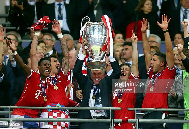 Head Coach Jupp Heynckes of Bayern Muenchen lifts the trophy after winning the UEFA Champions League final match against Borussia Dortmund at Wembley...