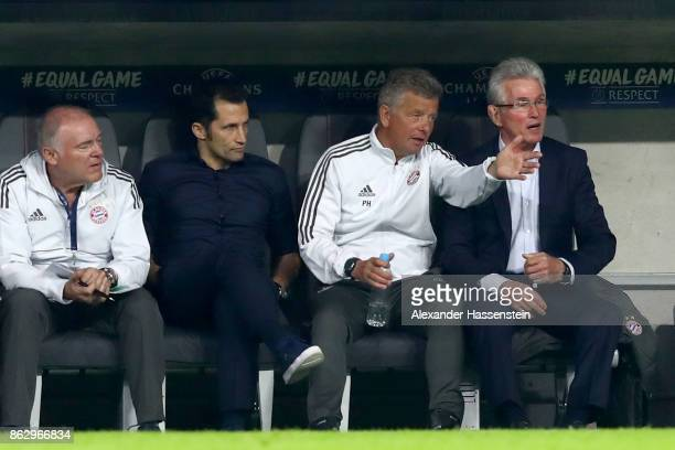 Head coach Jupp Heynckes of Bayern Muenchen sit on the team benach next to his assistent coach Peter Hermann sporting director Hasan Salihamidzic and...