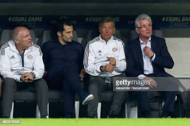 Head coach Jupp Heynckes of Bayern Muenchen sit on the team bench next to his assistent coach Peter Hermann sporting director Hasan Salihamidzic and...