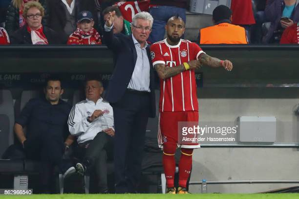 Head coach Jupp Heynckes of Bayern Muenchen talks to his player Arturo Vidal during the UEFA Champions League group B match between Bayern Muenchen...