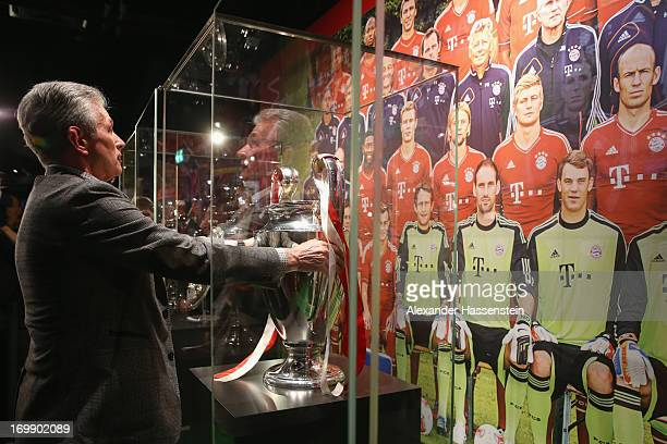 Head coach Jupp Heynckes of FC Bayern Muenchen places the UEFA Champions League winners trophy in Bayern Muenchen interactive club museum after a...