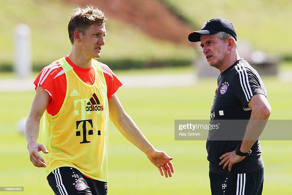 Head coach <a gi-track='captionPersonalityLinkClicked' href=/galleries/search?phrase=Jupp+Heynckes&family=editorial&specificpeople=2062040 ng-click='$event.stopPropagation()'>Jupp Heynckes</a> talks to <a gi-track='captionPersonalityLinkClicked' href=/galleries/search?phrase=Bastian+Schweinsteiger&family=editorial&specificpeople=203122 ng-click='$event.stopPropagation()'>Bastian Schweinsteiger</a> during a Bayern Muenchen training session at the ASPIRE Academy for Sports Excellence on January 5, 2013 in Doha, Qatar.