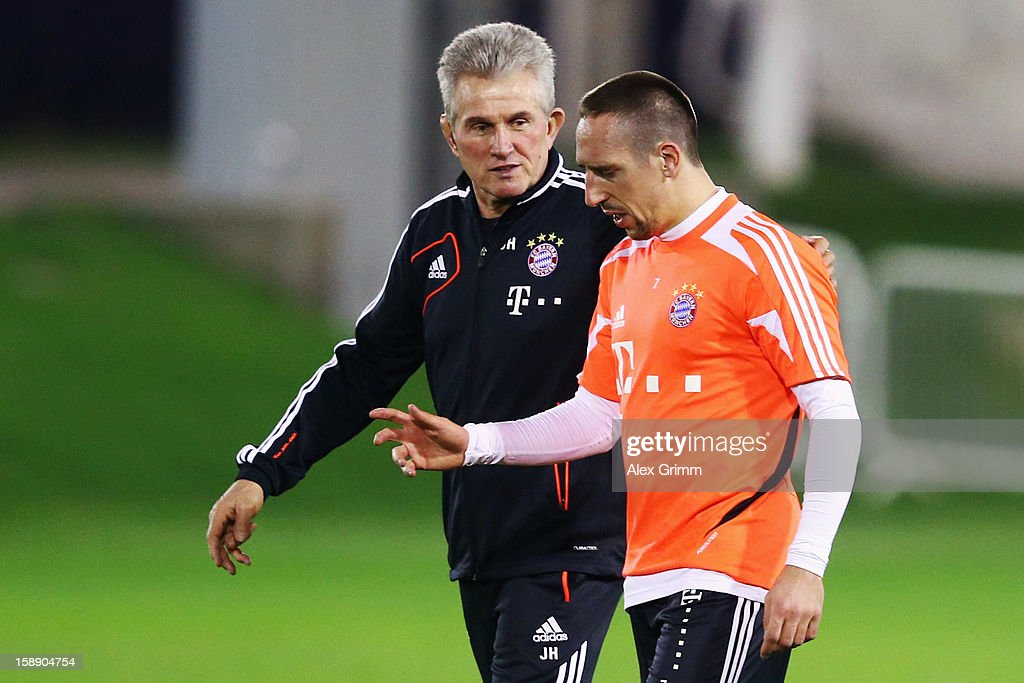 Head coach <a gi-track='captionPersonalityLinkClicked' href=/galleries/search?phrase=Jupp+Heynckes&family=editorial&specificpeople=2062040 ng-click='$event.stopPropagation()'>Jupp Heynckes</a> talks to <a gi-track='captionPersonalityLinkClicked' href=/galleries/search?phrase=Franck+Ribery&family=editorial&specificpeople=490869 ng-click='$event.stopPropagation()'>Franck Ribery</a> during a Bayern Muenchen training session at the ASPIRE Academy for Sports Excellence on January 3, 2013 in Doha, Qatar.