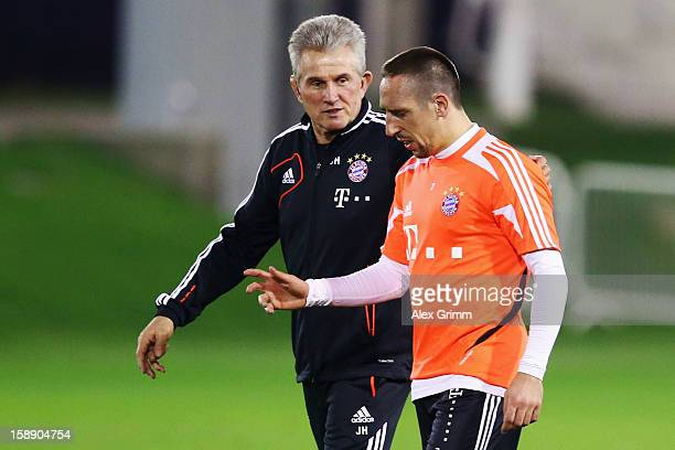 Head coach Jupp Heynckes talks to Franck Ribery during a Bayern Muenchen training session at the ASPIRE Academy for Sports Excellence on January 3...