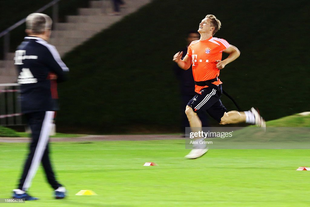 Head coach Jupp Heynckes watches Bastian Schweinsteiger run during a Bayern Muenchen training session at the ASPIRE Academy for Sports Excellence on January 3, 2013 in Doha, Qatar.