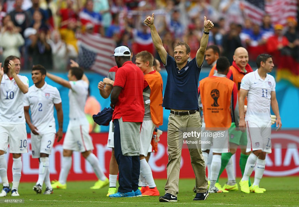 Head coach <a gi-track='captionPersonalityLinkClicked' href=/galleries/search?phrase=Jurgen+Klinsmann&family=editorial&specificpeople=228023 ng-click='$event.stopPropagation()'>Jurgen Klinsmann</a> of the United States acknowledges the fans after being defeated by Germany 1-0 during the 2014 FIFA World Cup Brazil Group G match between USA and Germany at Arena Pernambuco on June 26, 2014 in Recife, Brazil.