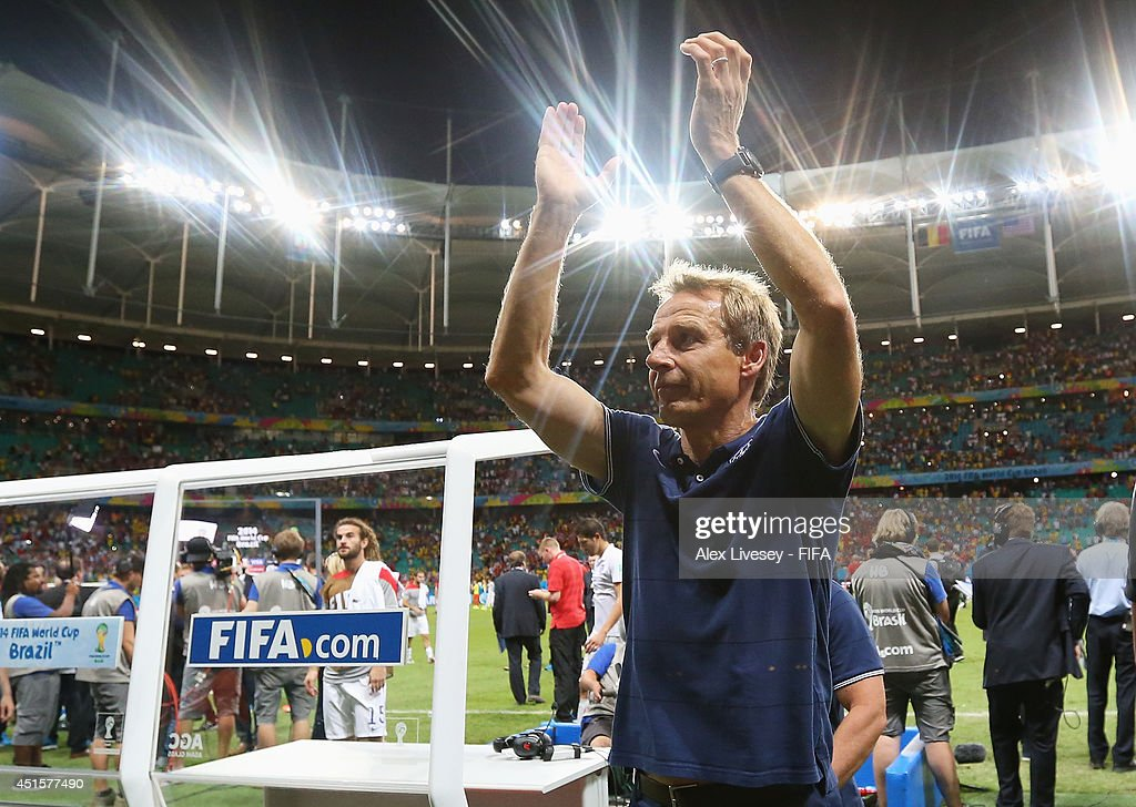Head coach <a gi-track='captionPersonalityLinkClicked' href=/galleries/search?phrase=Jurgen+Klinsmann&family=editorial&specificpeople=228023 ng-click='$event.stopPropagation()'>Jurgen Klinsmann</a> of the United States applauds the fans after losing the 2014 FIFA World Cup Brazil Round of 16 match between Belgium and USA at Arena Fonte Nova on July 1, 2014 in Salvador, Brazil.