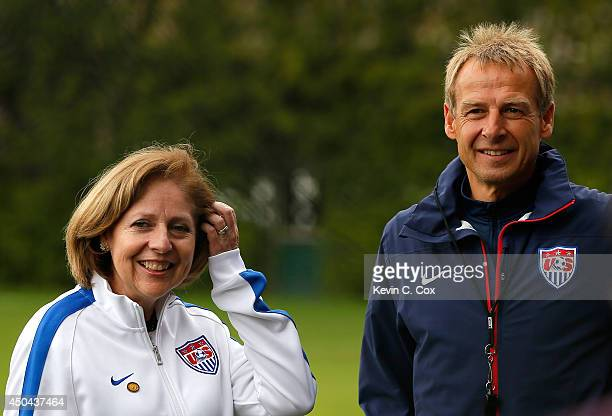 Head coach Jurgen Klinsmann of the United States converses with Liliana Ayalde the United States Ambassador to Brazil during the US Men's National...