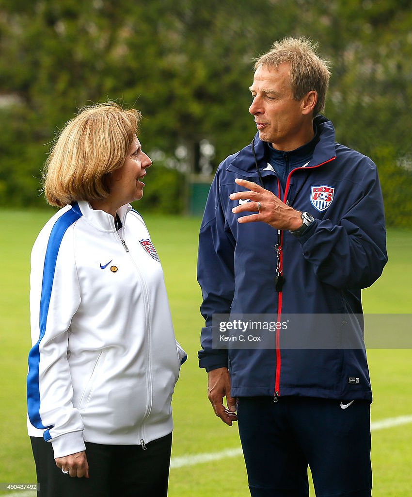 Head coach <a gi-track='captionPersonalityLinkClicked' href=/galleries/search?phrase=Jurgen+Klinsmann&family=editorial&specificpeople=228023 ng-click='$event.stopPropagation()'>Jurgen Klinsmann</a> of the United States converses with Liliana Ayalde, the United States Ambassador to Brazil, during the US Men's National Team training session at Sao Paulo FC on June 11, 2014 in Sao Paulo, Brazil.