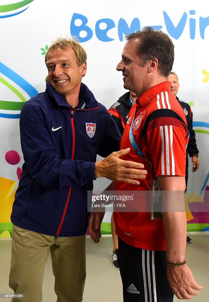 Head coach <a gi-track='captionPersonalityLinkClicked' href=/galleries/search?phrase=Jurgen+Klinsmann&family=editorial&specificpeople=228023 ng-click='$event.stopPropagation()'>Jurgen Klinsmann</a> (L) of the United States greets Germany team staff <a gi-track='captionPersonalityLinkClicked' href=/galleries/search?phrase=Tim+Meyer&family=editorial&specificpeople=623213 ng-click='$event.stopPropagation()'>Tim Meyer</a> (R) in the tunnel prior to the 2014 FIFA World Cup Brazil Group G match between USA and Germany at Arena Pernambuco on June 26, 2014 in Recife, Brazil.