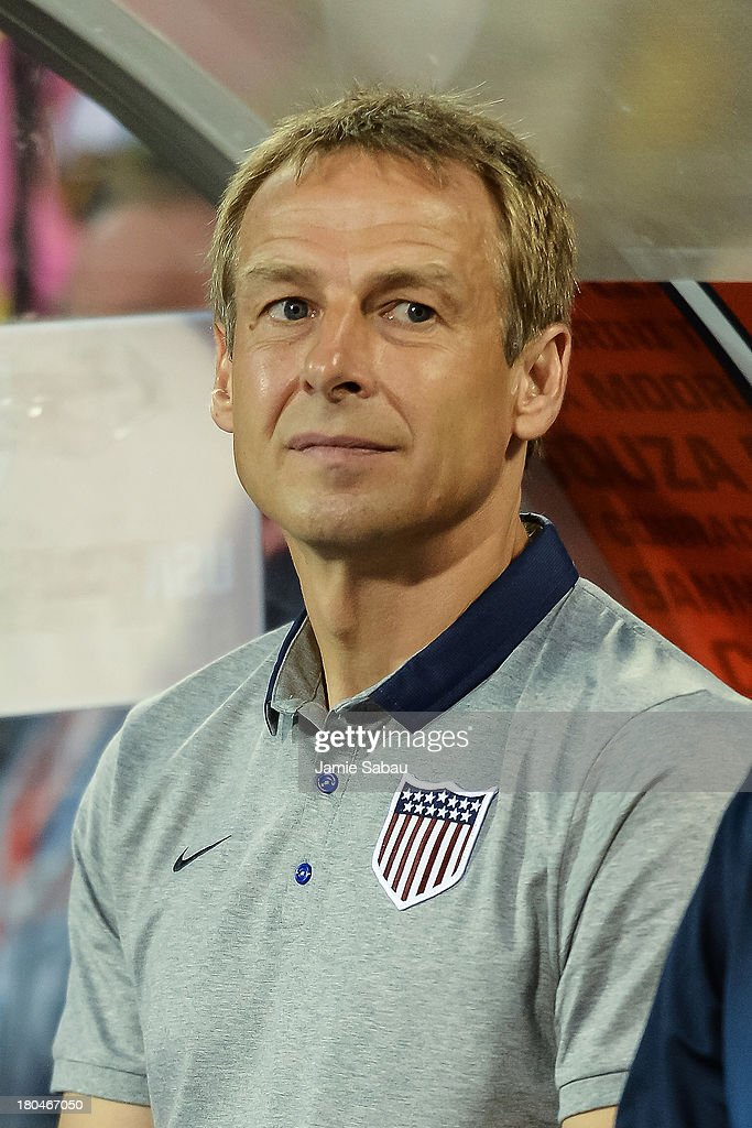 Head Coach Jurgen Klinsmann of the United States Men's National Team stands for the U.S. National Anthem before a game against Mexico at Columbus Crew Stadium on September 10, 2013 in Columbus, Ohio.